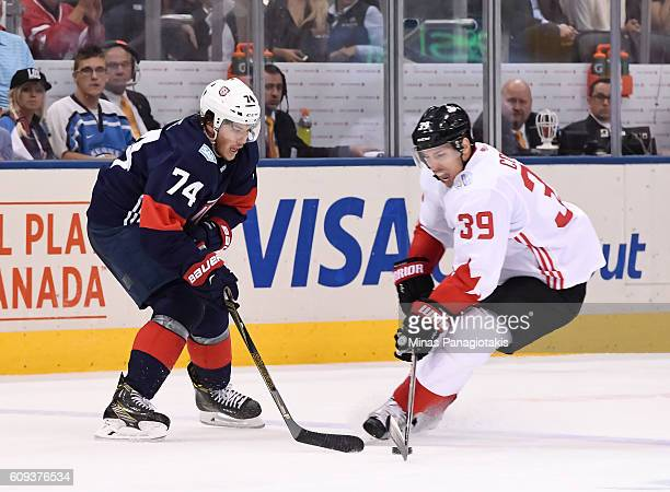 J Oshie of Team USA battles for a loose puck with Logan Couture of Team Canada during the World Cup of Hockey 2016 at Air Canada Centre on September...