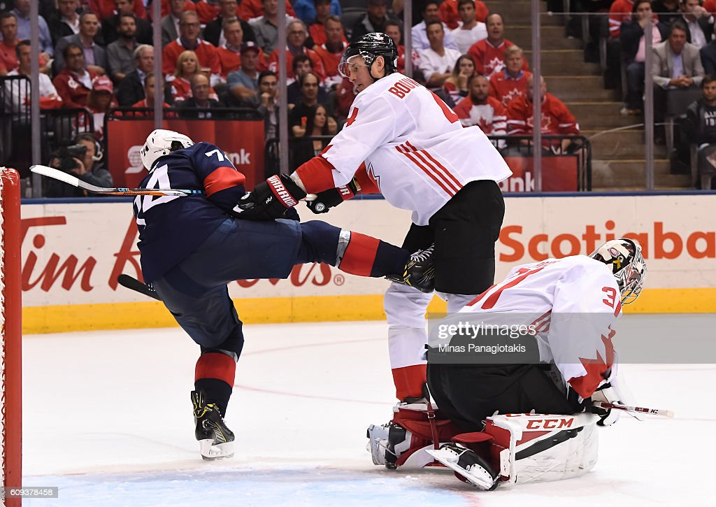 T.J. Oshie #74 of Team USA gets his skate tangled with Jay Bouwmeester #4 beside Carey Price #31 of Team Canada during the World Cup of Hockey 2016 at Air Canada Centre on September 20, 2016 in Toronto, Ontario, Canada.