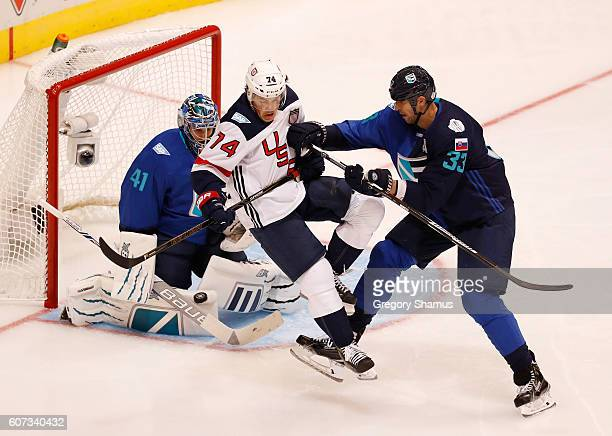 J Oshie of Team USA gets out of the way of a second period shot between Zdeno Chara and Jaroslav Halak of Team Europe during the World Cup of Hockey...