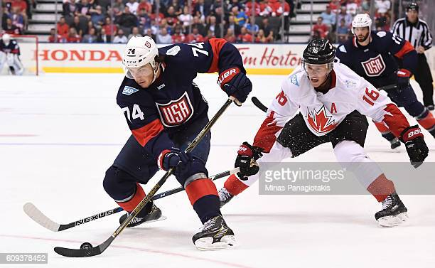 J Oshie of Team USA stickhandles the puck with Jonathan Toews of Team Canada chasing during the World Cup of Hockey 2016 at Air Canada Centre on...