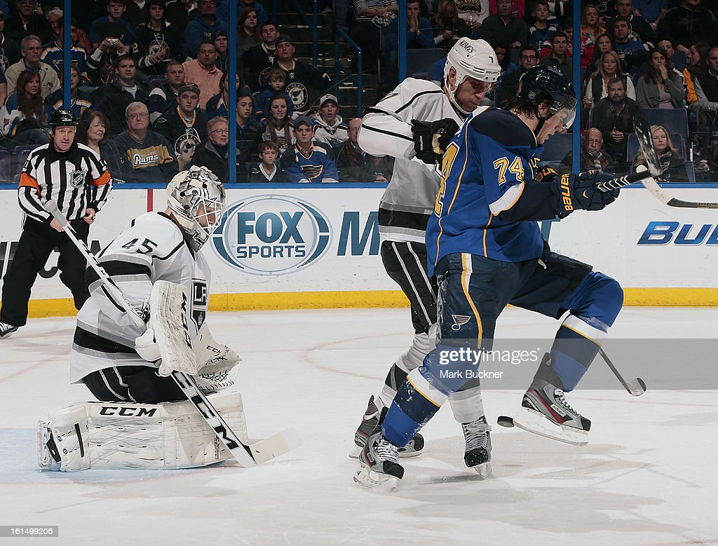 T.J. Oshie #74 of the St. Louis Blues avoids the puck as Rob Scuderi #7 and goalie Jonathan Bernier #45 of the Anaheim Ducks defend in an NHL game on February 11, 2013 at Scottrade Center in St. Louis, Missouri.