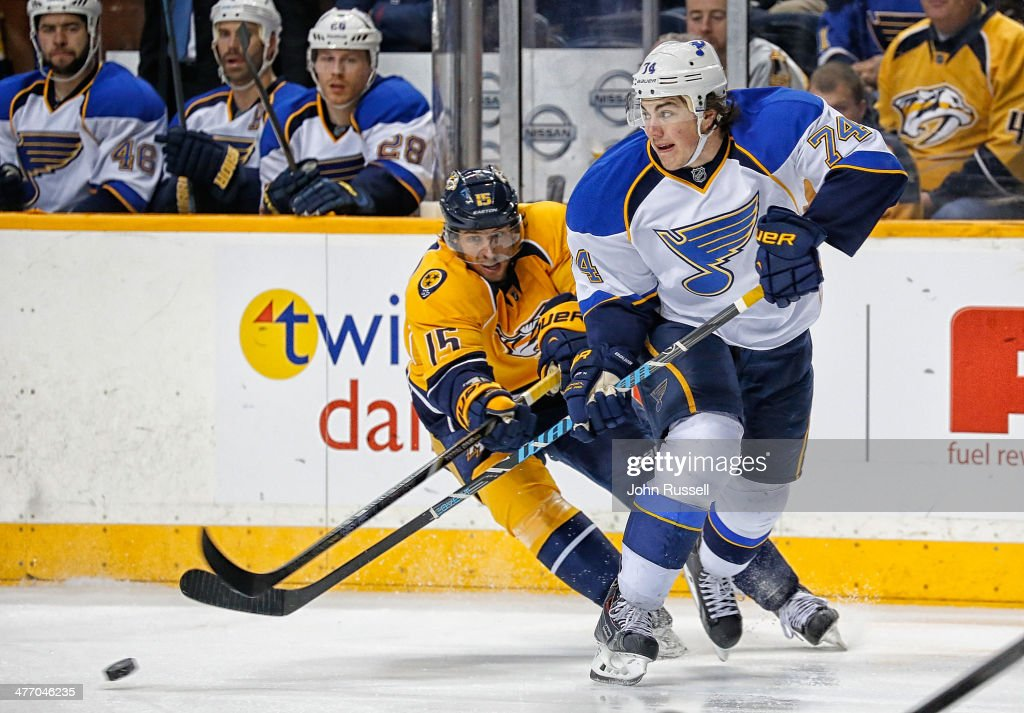 <a gi-track='captionPersonalityLinkClicked' href=/galleries/search?phrase=T.J.+Oshie&family=editorial&specificpeople=700383 ng-click='$event.stopPropagation()'>T.J. Oshie</a> #74 of the St. Louis Blues battles against Craig Smith #15 of the Nashville Predators at Bridgestone Arena on March 6, 2014 in Nashville, Tennessee.