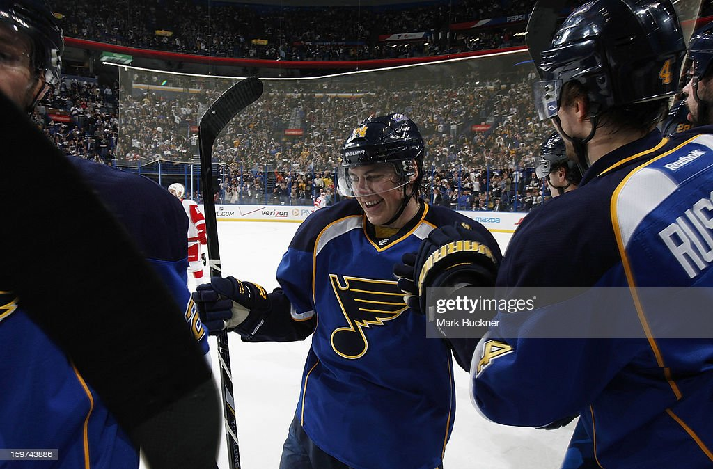 <a gi-track='captionPersonalityLinkClicked' href=/galleries/search?phrase=T.J.+Oshie&family=editorial&specificpeople=700383 ng-click='$event.stopPropagation()'>T.J. Oshie</a> #74 of the St. Louis Blues celebrates with teammates after scoring a goal in an NHL game against the Detroit Red Wings on January 19, 2013 at Scottrade Center in St. Louis, Missouri.
