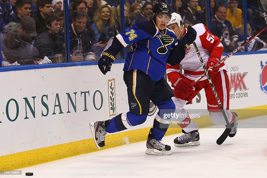 <a gi-track='captionPersonalityLinkClicked' href=/galleries/search?phrase=T.J.+Oshie&family=editorial&specificpeople=700383 ng-click='$event.stopPropagation()'>T.J. Oshie</a> #74 of the St. Louis Blues looks to beat <a gi-track='captionPersonalityLinkClicked' href=/galleries/search?phrase=Valtteri+Filppula&family=editorial&specificpeople=2234404 ng-click='$event.stopPropagation()'>Valtteri Filppula</a> #51 of the Detroit Red wings to the puck at the Scottrade Center on January 19, 2013 in St. Louis, Missouri.