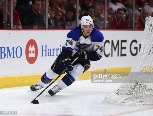 J Oshie of the St Louis Blues moves behind the net to shoot against the Chicago Blackhawks at the United Center on March 19 2014 in Chicago Illinois