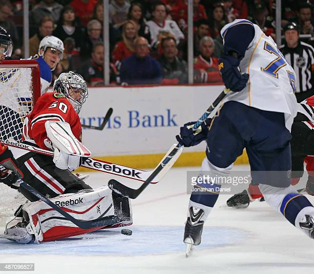 J Oshie of the St Louis Blues scores a goal against Corey Crawford of the Chicago Blackhawks in Game Six of the First Round of the 2014 NHL Stanley...