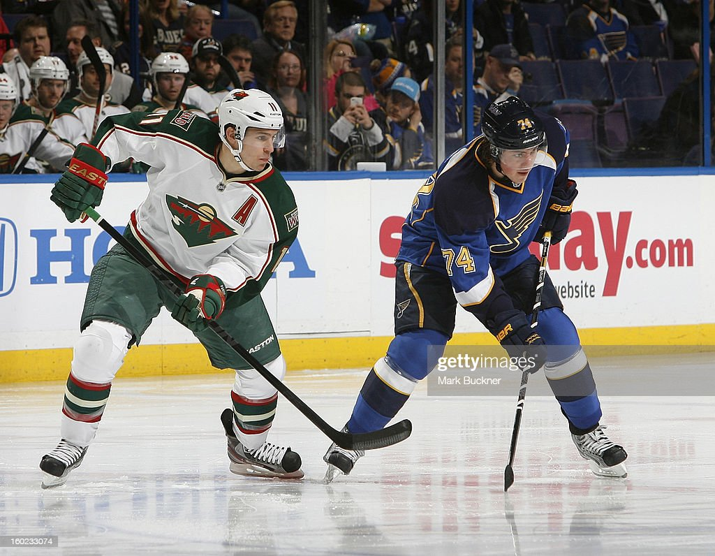 T.J. Oshie #74 of the St. Louis Blues waits for a face off with Zach Parise #11 of the Minnesota Wild in an NHL game on January 27, 2013 at Scottrade Center in St. Louis, Missouri.