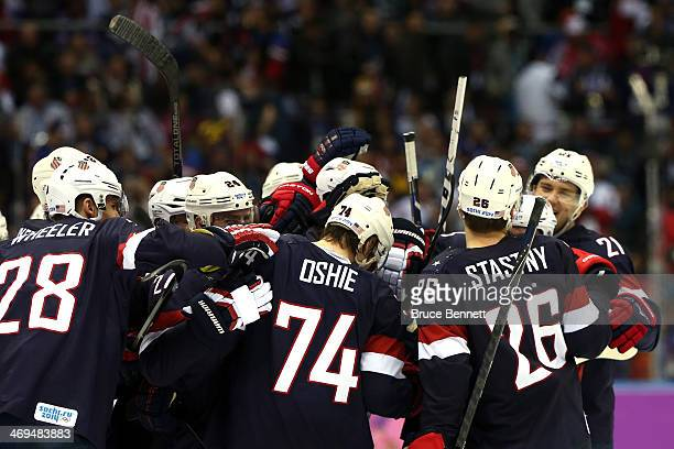 J Oshie of the United States celebrates with teammates after scoring on a shootout against Sergei Bobrovski of Russia to win the Men's Ice Hockey...