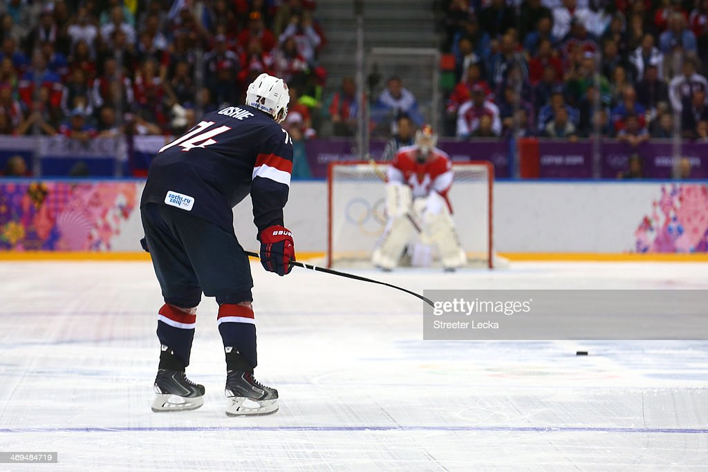 <a gi-track='captionPersonalityLinkClicked' href=/galleries/search?phrase=T.J.+Oshie&family=editorial&specificpeople=700383 ng-click='$event.stopPropagation()'>T.J. Oshie</a> #74 of the United States scores on a shootout against Sergei Bobrovski #72 of Russia during the Men's Ice Hockey Preliminary Round Group A game on day eight of the Sochi 2014 Winter Olympics at Bolshoy Ice Dome on February 15, 2014 in Sochi, Russia.