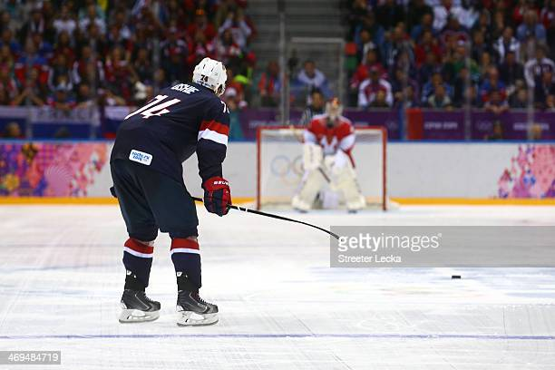 J Oshie of the United States scores on a shootout against Sergei Bobrovski of Russia during the Men's Ice Hockey Preliminary Round Group A game on...