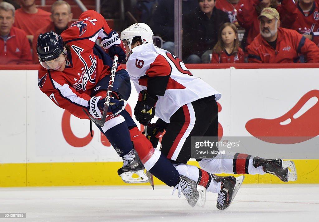 J Oshie of the Washington Capitals and Bobby Ryan of the Ottawa Senators collide at the Verizon Center on January 10 2016 in Washington DC