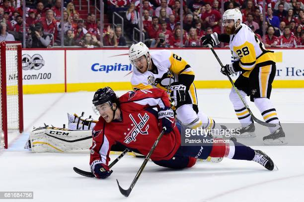 J Oshie of the Washington Capitals and Chad Ruhwedel of the Pittsburgh Penguins battle for the puck in the second period in Game Seven of the Eastern...