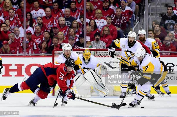 J Oshie of the Washington Capitals and Matt Cullen of the Pittsburgh Penguins battle for the puck in the third period in Game Seven of the Eastern...