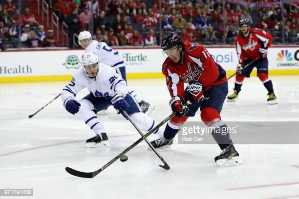 J Oshie of the Washington Capitals and Nikita Zaitsev of the Toronto Maple Leafs go after the puck in the second period in Game Five of the Eastern...