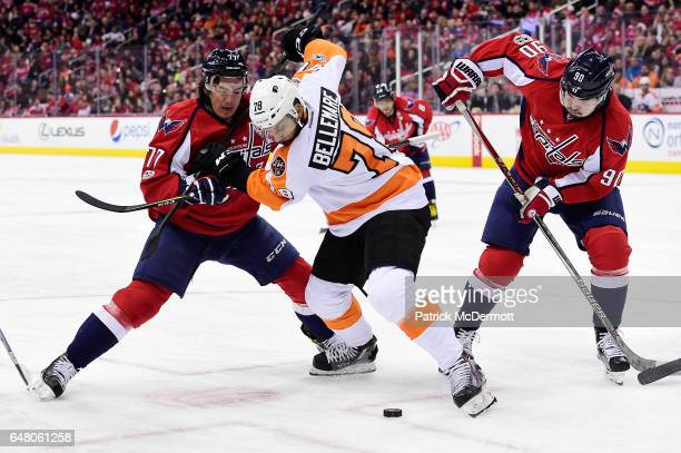 J Oshie of the Washington Capitals and PierreEdouard Bellemare of the Philadelphia Flyers battle for a faceoff in the first period during an NHL game...
