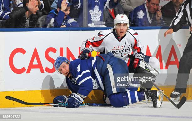 J Oshie of the Washington Capitals battles against Leo Komarov of the Toronto Maple Leafs in Game Three of the Eastern Conference Quarterfinals...