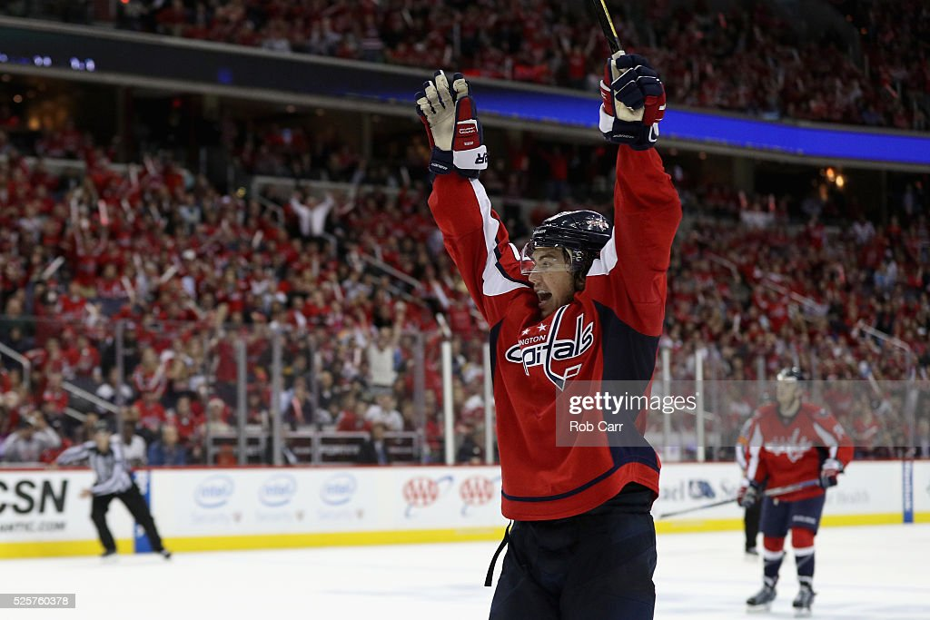 T.J. Oshie #77 of the Washington Capitals celebrates after scoring the game winning goal to give the Capitals a 4-3 overtime win against the Pittsburgh Penguins in Game One of the Eastern Conference Second Round during the 2016 NHL Stanley Cup Playoffs at Verizon Center on April 28, 2016 in Washington, DC.