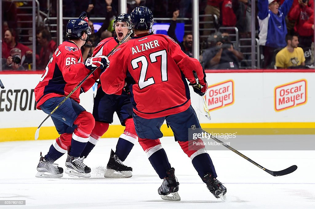 <a gi-track='captionPersonalityLinkClicked' href=/galleries/search?phrase=T.J.+Oshie&family=editorial&specificpeople=700383 ng-click='$event.stopPropagation()'>T.J. Oshie</a> #77 of the Washington Capitals celebrates his game winning goal and hat trick against the Pittsburgh Penguins in overtime in Game One of the Eastern Conference Second Round during the 2016 NHL Stanley Cup Playoffs at Verizon Center on April 28, 2016 in Washington, DC. The Capitals defeated the Penguins 4-3 in overtime.