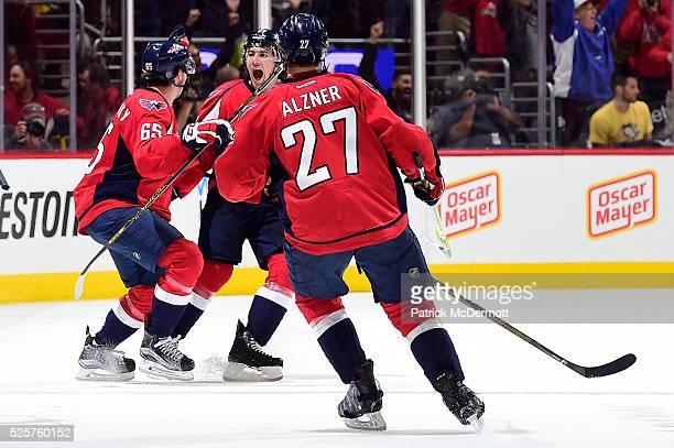 J Oshie of the Washington Capitals celebrates his game winning goal and hat trick against the Pittsburgh Penguins in overtime in Game One of the...