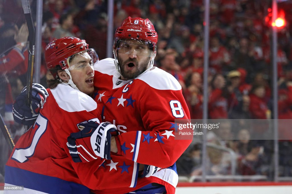 T.J. Oshie #77 of the Washington Capitals (L) celebrates his goal with teammate Alex Ovechkin #8 against the Detroit Red Wings during the second period at Verizon Center on February 9, 2017 in Washington, DC.