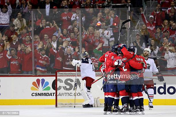 J Oshie of the Washington Capitals celebrates with teammates after scoring a goal against the Columbus Blue Jackets during the third period at...