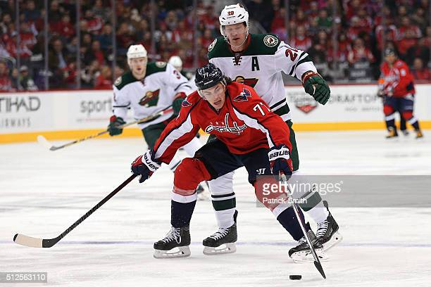 J Oshie of the Washington Capitals controls the puck in front of Ryan Suter of the Minnesota Wild during the third period at Verizon Center on...