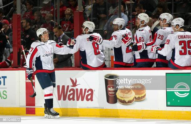 J Oshie of the Washington Capitals is congratulated by his teammates after scoring a firstperiod goal against the New Jersey Devils during the game...