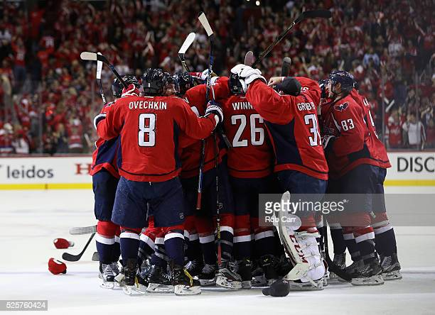 J Oshie of the Washington Capitals is mobbed by teammates after scoring the game winning goal to give the Capitals a 43 overtime win over the...