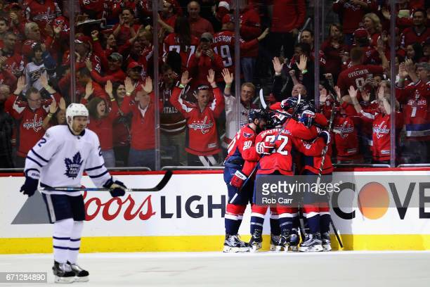 J Oshie of the Washington Capitals is mobbed by teammates after scoring a first period goal against the Toronto Maple Leafs in Game Five of the...