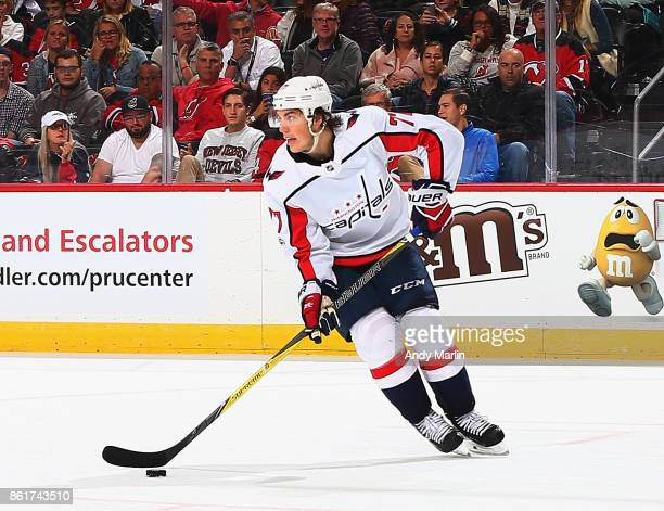 J Oshie of the Washington Capitals plays the puck against the New Jersey Devils during the game at Prudential Center on October 13 2017 in Newark New...