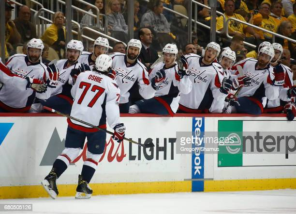 J Oshie of the Washington Capitals reacts after scoring a goal against the Pittsburgh Penguins in Game Six of the Eastern Conference Second Round...