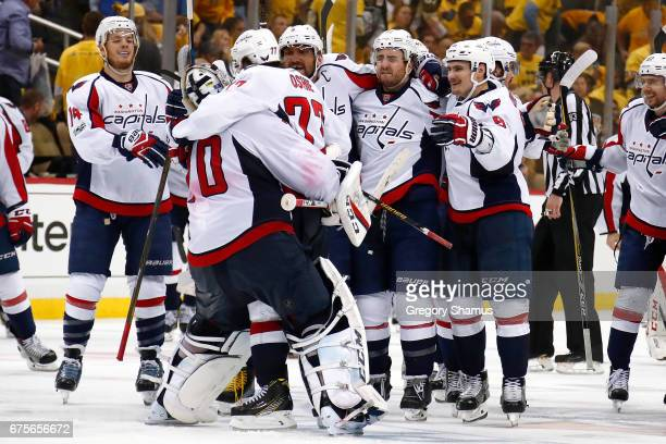 J Oshie of the Washington Capitals reacts with teammates and Braden Holtby after his teammate Kevin Shattenkirk scored in overtime to beat the...
