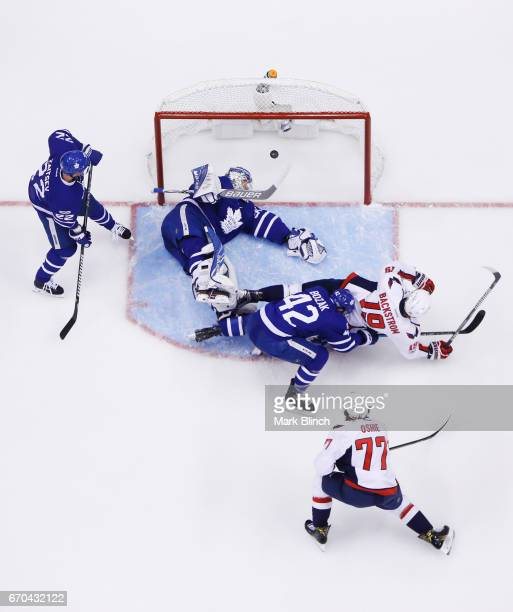 J Oshie of the Washington Capitals scores past Tyler Bozak Frederik Andersen of the Toronto Maple Leafs and Nicklas Backstrom of the Washington...