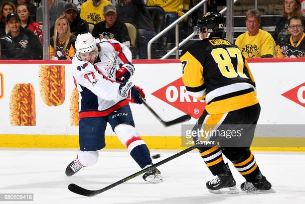 J Oshie of the Washington Capitals takes a shot against Sidney Crosby of the Pittsburgh Penguins in Game Six of the Eastern Conference Second Round...