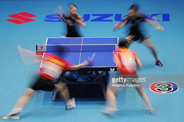 Oshima Yuya and Wakamiya Misako of Japan compete against Fan Zhendong and Chen Meng of China during Mixed doubles semifinal match of the 22nd 2015...