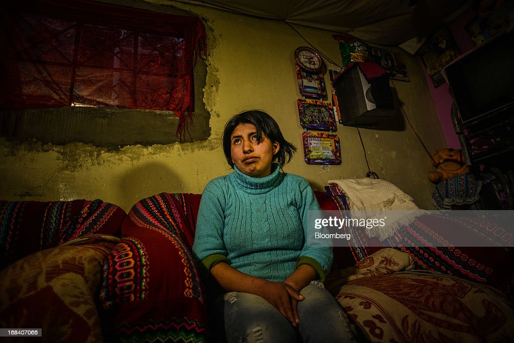Oshin Onofre, a 21-year-old who says she started having convulsions and headaches 10 years ago, sits on a couch in the town of La Oroya, Peru, on Tuesday, March 19, 2013. Most of La Oroyaís children suffer elevated lead levels, according to the Peruvian government. The question of responsibility for lead pollution in La Oroya is at the center of high-stakes clash between Peru and U.S. billionaire Ira Rennert, who owned Doe Run Peru for more than a decade through Renco Group Inc., a metals, mining and industrial conglomerate based in New York that has said it is not responsible for the childrenís ills.Photographer: Meridith Kohut/Bloomberg via Getty Images