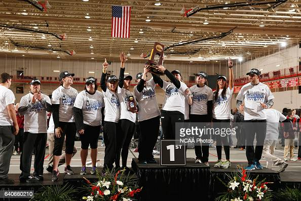 Oshkosh Women's Track Team raises up their Championship trophy at the Division III Men's and Women's Indoor Track and Field Championships held at the...