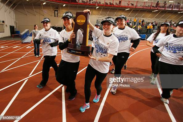 Oshkosh Women's Track Team takes a victory lap with their Championship trophy at the Division III Men's and Women's Indoor Track and Field...