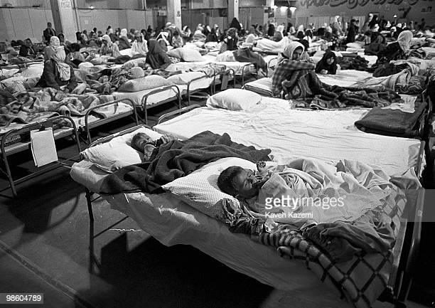 Iraqi Kurds sit in a makeshift hospital in Oshnavieh Iran after having fled a chemical gas attack in northern Iraq 5th August 1988 Towards the end of...