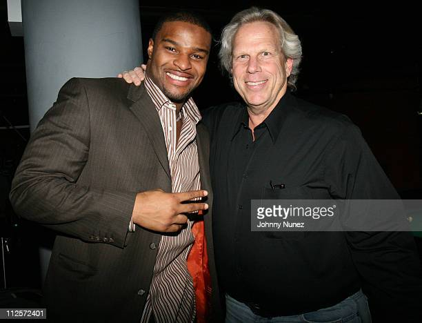 Osi Umenyiora and Steve Tisch attend Michael Strahan's Santa's BIG Helper Christmas Party at Club Slate December 17 2007 in New York City