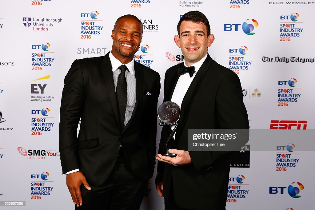 Osi Umenyiora (L) presents Brand of the Year in association with Pinsent Masons to adidas at the BT Sport Industry Awards 2016 at Battersea Evolution on April 28, 2016 in London, England. The BT Sport Industry Awards is the most prestigious commercial sports awards ceremony in Europe, where over 1750 of the industry's key decision-makers mix with high profile sporting celebrities for the most important networking occasion in the sport business calendar.