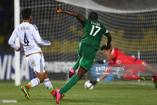 Osinachi Ebere of Nigeria scores his team's third goal against Francisco Venegas and goalkeeper Abraham Romero of Mexico during the FIFA U17 World...