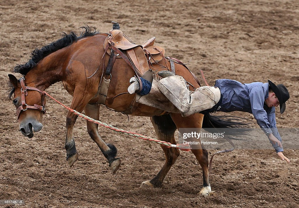 Oskar Auker is thrown from his horse as he competes in the Saddle Bronc Riding at the Prescott Frontier Days 'World's Oldest Rodeo' on July 5, 2014 in Prescott, Arizona.