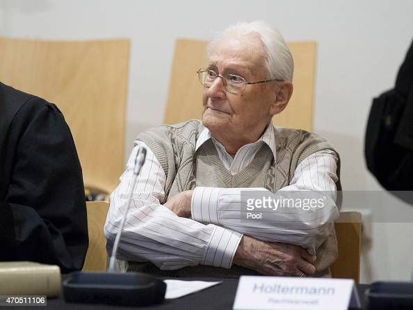 Oskar Groening arrives for the first day of his trial to face charges of being accomplice to the murder of 300000 people at the Auschwitz...