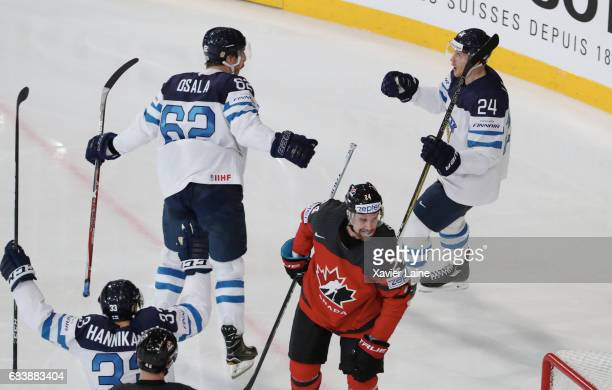 Oskar Osala and Jani Lajunen of Finalnd celebrate a goal during the 2017 IIHF Ice Hockey World Championship game between Canada and Finland at...