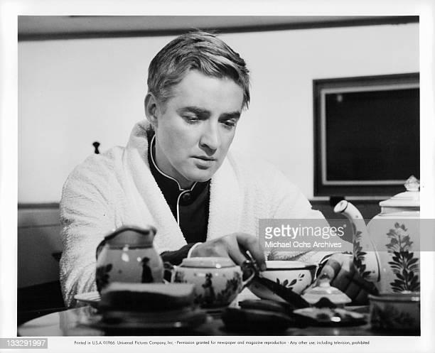 Oskar Werner eats breakfast in a scene from the film Fahrenheit 451' 1966