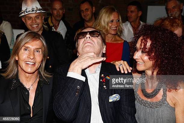 Oskar Wess Helmut Berger and Christina aka Mausi Lugner attend the GarconF fashion show at BalloniHallen on August 5 2014 in Cologne Germany