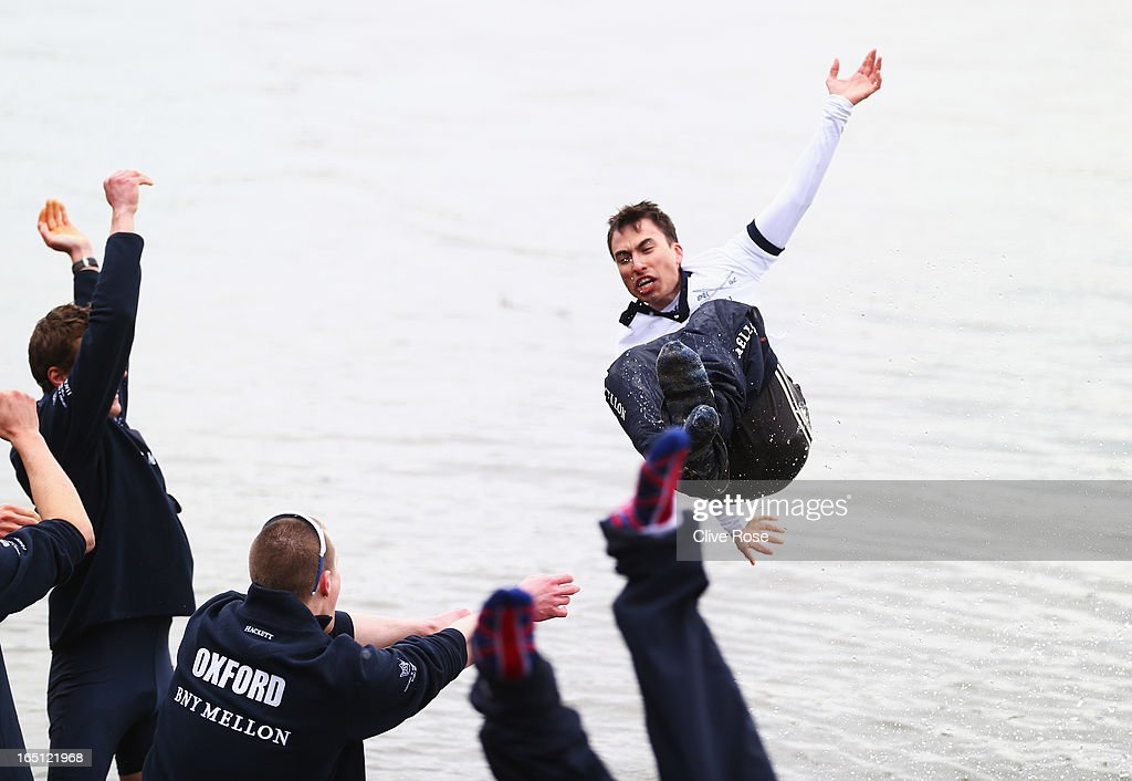 Oskar Zorrilla of Oxford the winning cox is thrown into the River Thames after the BNY Mellon 159th Oxford versus Cambridge University Boat Race on...