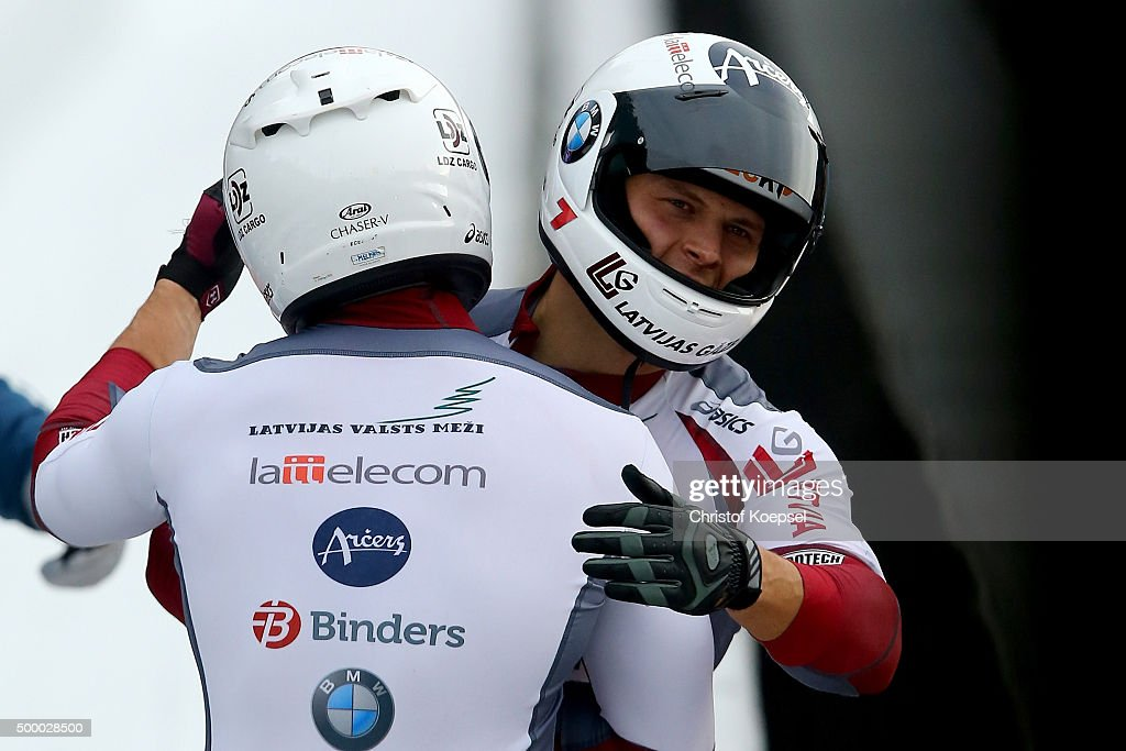 Oskars Melbardis and Daumants Dreisekens of Latvia celebrta winning their second place of the two men's bob competition during the BMW IBSF Bob...