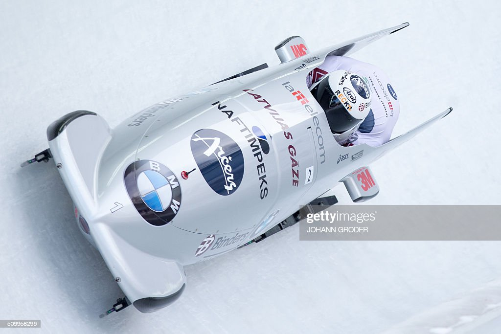 Oskars Melbardis and Daumants Dreiskens of Latvia compete during the second run of the two-men Bobsleigh event of the Bobsleigh and Skeleton World Championships in Innsbruck/Igls, Austria, February 13, 2016. / AFP / APA / Johann Groder / Austria OUT